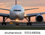 Small photo of Modern civil passenger airliner taking off at airport during sunset.