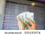Stock photo finance currency conversion and people concept hands with euro money over exchange rates on 555192976
