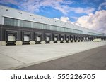 loading dock cargo doors at big ... | Shutterstock . vector #555226705