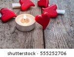 burning candle and hearts on... | Shutterstock . vector #555252706