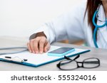 close up of a female doctor in... | Shutterstock . vector #555324016