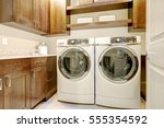 white and brown laundry room... | Shutterstock . vector #555354592