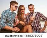 friends on holiday. | Shutterstock . vector #555379006