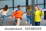 group of happy children playing ... | Shutterstock . vector #555385255