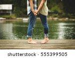 feet of a couple on a dock | Shutterstock . vector #555399505