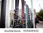 Mardi Gras Beads On A Fence In...