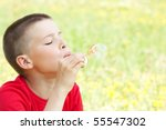boy blowing bubbles at the park | Shutterstock . vector #55547302