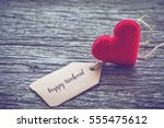 red heart shape with happy... | Shutterstock . vector #555475612