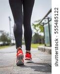 runner feet running on road... | Shutterstock . vector #555485122