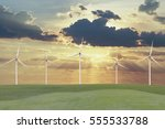 wind turbines on grass field... | Shutterstock . vector #555533788