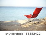 On the beach, chair for resting - stock photo