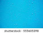 Water Drops On Blue Background.