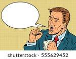 sick man coughing. pop art... | Shutterstock .eps vector #555629452