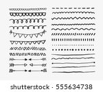 set of hand drawn lines and... | Shutterstock .eps vector #555634738
