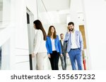 teamwork walking at door in the ... | Shutterstock . vector #555657232