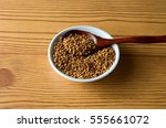fenugreek spice in white bowl... | Shutterstock . vector #555661072