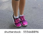 young  woman's legs with... | Shutterstock . vector #555668896
