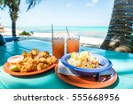 conch fritters and conch salad... | Shutterstock . vector #555668956