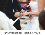 detail of couple's hands... | Shutterstock . vector #555677476