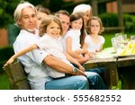 big family having a picnic in... | Shutterstock . vector #555682552