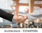 businessman handshake for... | Shutterstock . vector #555689086
