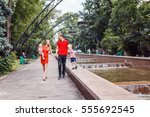 young couple in the park with... | Shutterstock . vector #555692545