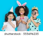 little kids hands hold props... | Shutterstock . vector #555696235