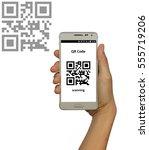 scanning qr code concept ... | Shutterstock . vector #555719206