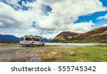 Motorhome parked by river in the Southern Alps of New Zealand. - stock photo