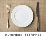 top view of white plate with... | Shutterstock . vector #555784486