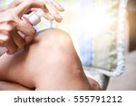 the woman is to apply lotion on ... | Shutterstock . vector #555791212