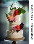 beautiful white wedding cake... | Shutterstock . vector #555793846