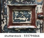Small photo of Old door in maintenance with abraded paint