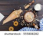 cooked porridge oatmeal in a... | Shutterstock . vector #555808282
