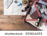 Small photo of prepare accessories and travel items on white wooden board, flat lay, top view background