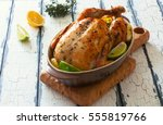 fried whole chicken with apples ... | Shutterstock . vector #555819766