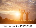 silhouette of a happy family... | Shutterstock . vector #555856162