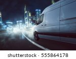 delivery van drives at night | Shutterstock . vector #555864178