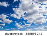 clouds on a blue sky in summer | Shutterstock . vector #555895246