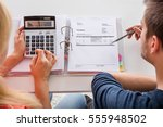 close up of couple calculating... | Shutterstock . vector #555948502