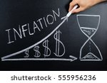 person hand showing inflation... | Shutterstock . vector #555956236
