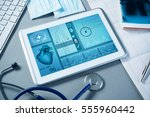 white tablet pc and doctor... | Shutterstock . vector #555960442