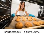 young happy woman baking fresh... | Shutterstock . vector #555962092