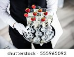 waiter standing with champagne... | Shutterstock . vector #555965092