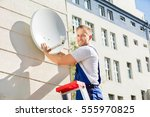 Young Man Fitting Tv Satellite...