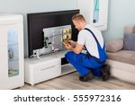 young male electrician in... | Shutterstock . vector #555972316