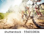 mountain biker riding through a ... | Shutterstock . vector #556010836