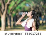 asian young woman drinking... | Shutterstock . vector #556017256