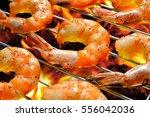 grilled shrimps prawns on the... | Shutterstock . vector #556042036