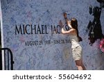 Small photo of LOS ANGELES, CA- JULY 5 : Giant Michael Jackson's billboard installed outside Staples Center to be signed by fans, July 5, 2009 in Los Angeles, California.